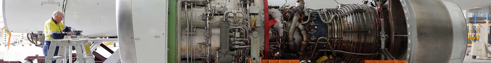Aviat Global engineer working on a V2500 jet engine