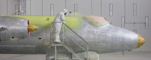 Aviat Global aircraft refinisher spraying a Canberra bomber