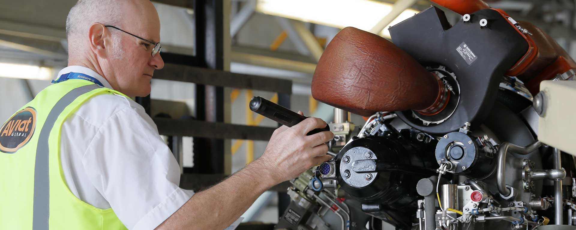 Aviat Global engineer inspecting a jet engine